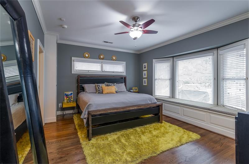 Tons of natural light in the master suite with adorable bench seating along bay window too!