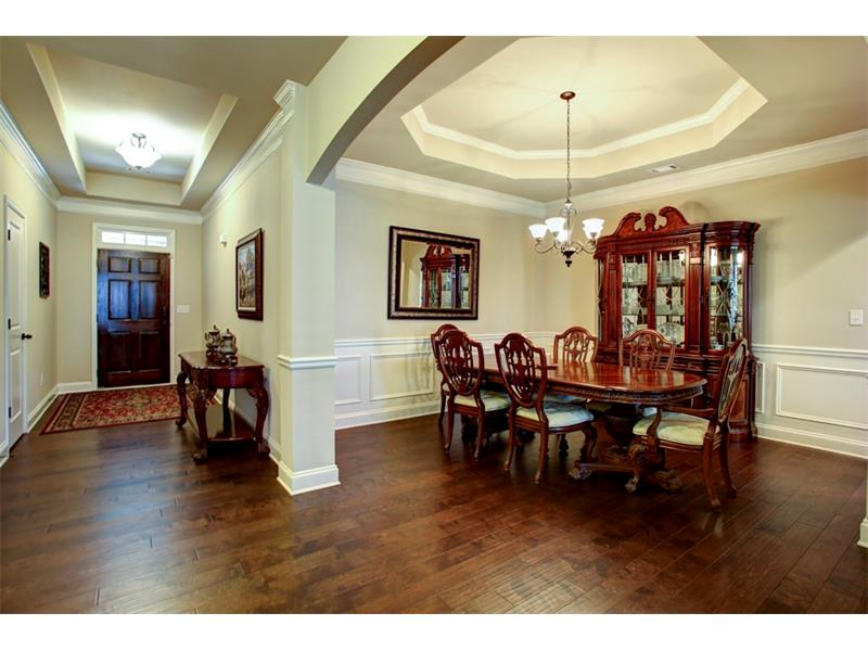 Trey ceiling accents the foyer & dining room are the perfect compliment!