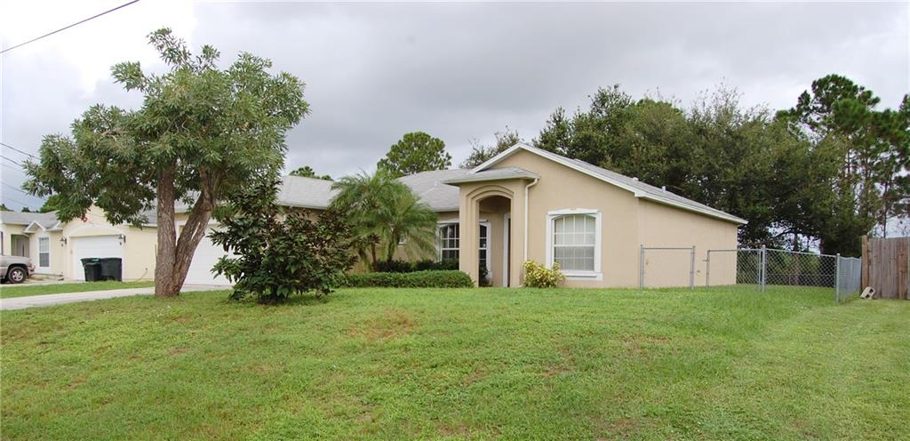 Charming 3 bedroom, 2 bath, 2 car garage CBS construction home close to Traditions in Port St. Lucie! This is a must see as the owner just installed a brand new white appliance package in the kitchen, flooring consists of tile throughout the main living area and master bedroom, carpet in 2nd and 3rd bedrooms. Fenced-in yard that backs to the preserve area for privacy and great views. Don't miss out!