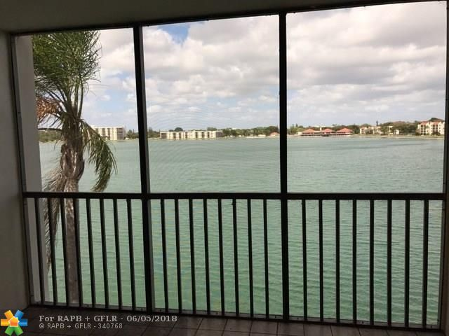 Top floor, two bedroom condominium in beautiful Lake Emerald community. Unit features two full bathrooms that have been updated. Also there are gorgeous views of the lake from the living area, screened patio and master bedroom. This is a active community with a gym, tennis courts, multiple pools, basketball, library, tiki huts/grills and other amenities that remind you of resort life. The association includes water, access to amenities, exterior insurance, and cable tv (HBO/Showtime). This is a guard gated community with 24 hr. security patrol. Currently this unit is tenant occupied (month to month) so call/text for showings and questions and send offers. VA approved condo community.