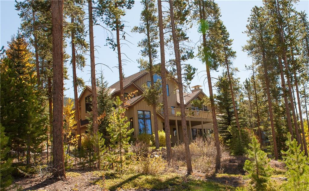 Spectacular panoramic views of Lake Dillon and the Gore Range are captured from this classic home designed by Janet Sutterly and constructed by Infinite Scope atop Mountain Bluebell Road.  Meticulously maintained, this home features an open great room with vaulted ceilings, a large west facing deck and lower patio area among mature trees which frame one of the best views in Keystone.  A private master suite plus three ensuite bedrooms and a large, sun-filled family room complete this home.