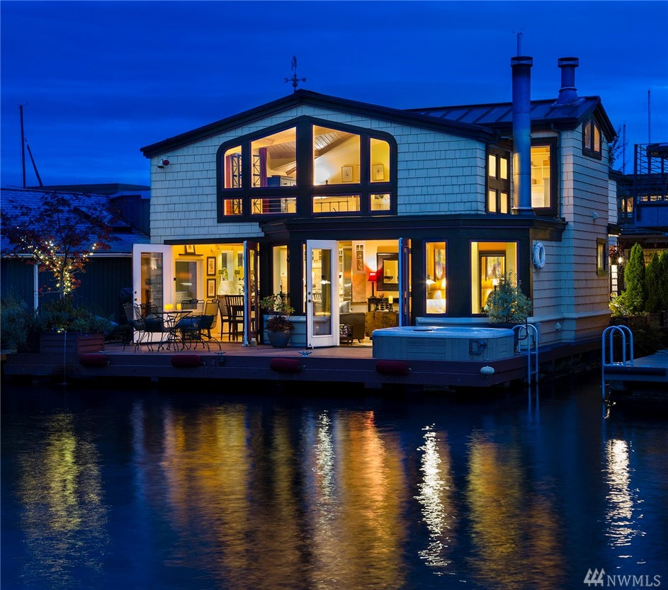 One of the most beautiful houseboats in Seattle. Extraordinary views & uniquely private on a wonderful dock. Great room is flooded with natural light & 2 stories of windows, with French doors opening to the spacious deck.Gorgeous kitchen opens to the indoor & outdoor dining, ideal for entertaining. 4 Bedrooms, including a master with fireplace & big views  Absolutely spotless. Hot tub on the deck is ideal for a starlit night. Pet friendly dock.Christmas ships, 4th of July, boat to the San Juans.