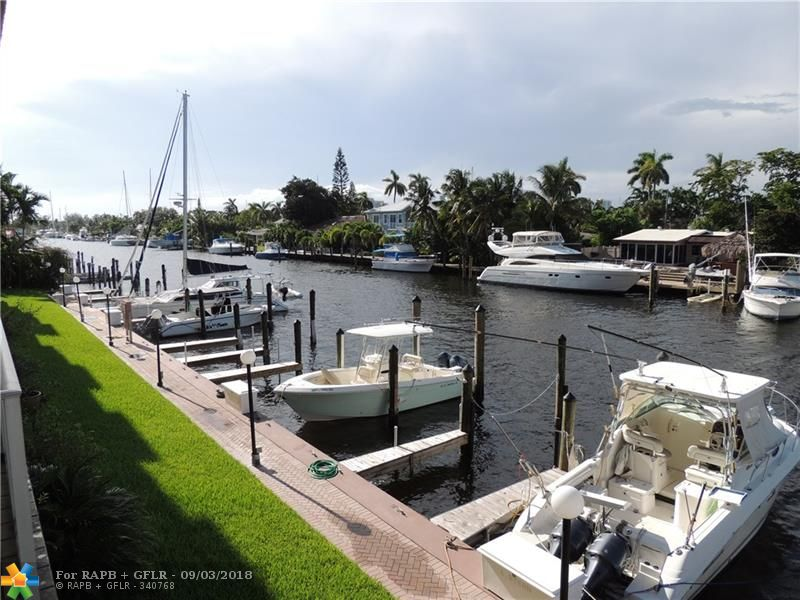 Located on the sought after SE 15th Street this clean and quaint condo is surrounded by marina's, hospitals, schools, yacht clubs and Fort Lauderdale's best food and dining. Once you walk through the door you have views of the boats, water, and a glimpse of the pool and Intracoastal. New tile throughout except in the bathrooms where it remains original. Granite counter tops & back splash in the kitchen with stainless steel range and dishwasher. A great place for simple yet sophisticated living.
