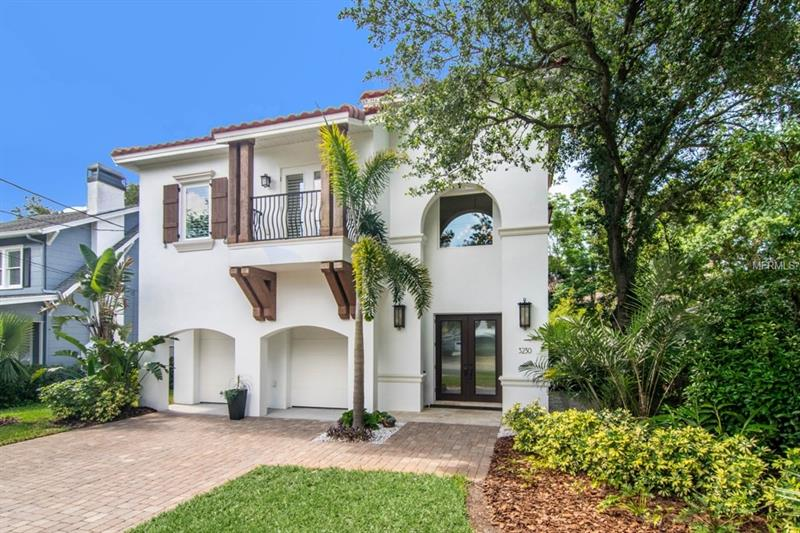 This exceptional home designed by Joe Toph and built by Gabler Brothers, is nestled in one of Bayshore Beautiful's  most desired streets, just a few blocks from Bayshore Blvd and a short walk to the South Tampa YMCA. This solid block home with double front doors welcome you in to a majestic grand foyer with 25 ft. ceiling, picture niches and a gorgeous wrought iron staircase. The open floor plan with 12 ft. ceilings gives you a feeling of spaciousness and style, where all flows naturally. The gourmet kitchen is equipped with top of the line appliances (Wolf ovens and cook top, Sub-Zero refrigerator, U-line wine cooler). With its oversized bullnose granite counter tops and large island, extra tall cherry cabinetry and a walk in pantry. The dining room looks out to a beautiful water feature fountain and the family room is focused on a stone wall with linear gas fireplace and French doors leading to your own private oasis. With an outdoor kitchen, abundant landscaping and travertine floors that continue from the indoor out, this home is perfect for entertaining. You will also find a guest suite and office downstairs. Walk up the stairs to a spacious landing with Brazilian cherry hardwood floor, 3 spacious bedrooms and a Jack & Jill bath.  The master retreat is spacious with her and his closets; master bath is roomy and stylish featuring a separate spa like tub. Attention to detail, high end finishes, plantation shutters, surround sound and rich wood trim are seen throughout this gem. If you like space and elegance, this is your home!