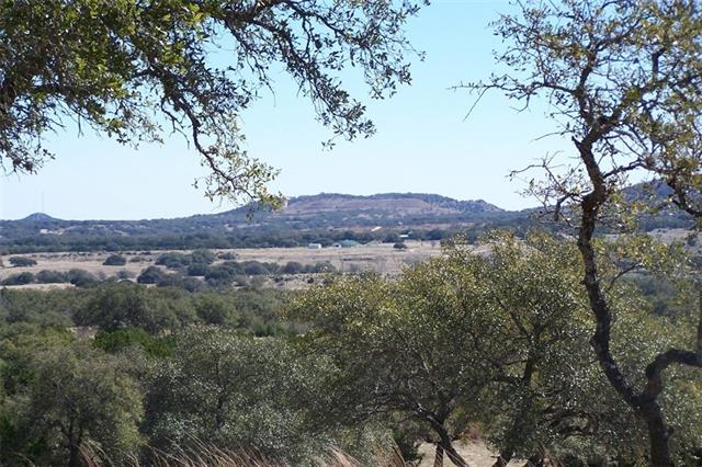 Excellent lot in Marshall Ridge close to Johnson City and the 290 Wine Trail.  Many large liveoaks and elms.  Most cedar has been cleared, some left on fringes of lot.  There are several excellent building sites with excellent views.  Sensible restrictions.  Ag Exemption.  No well or septic.