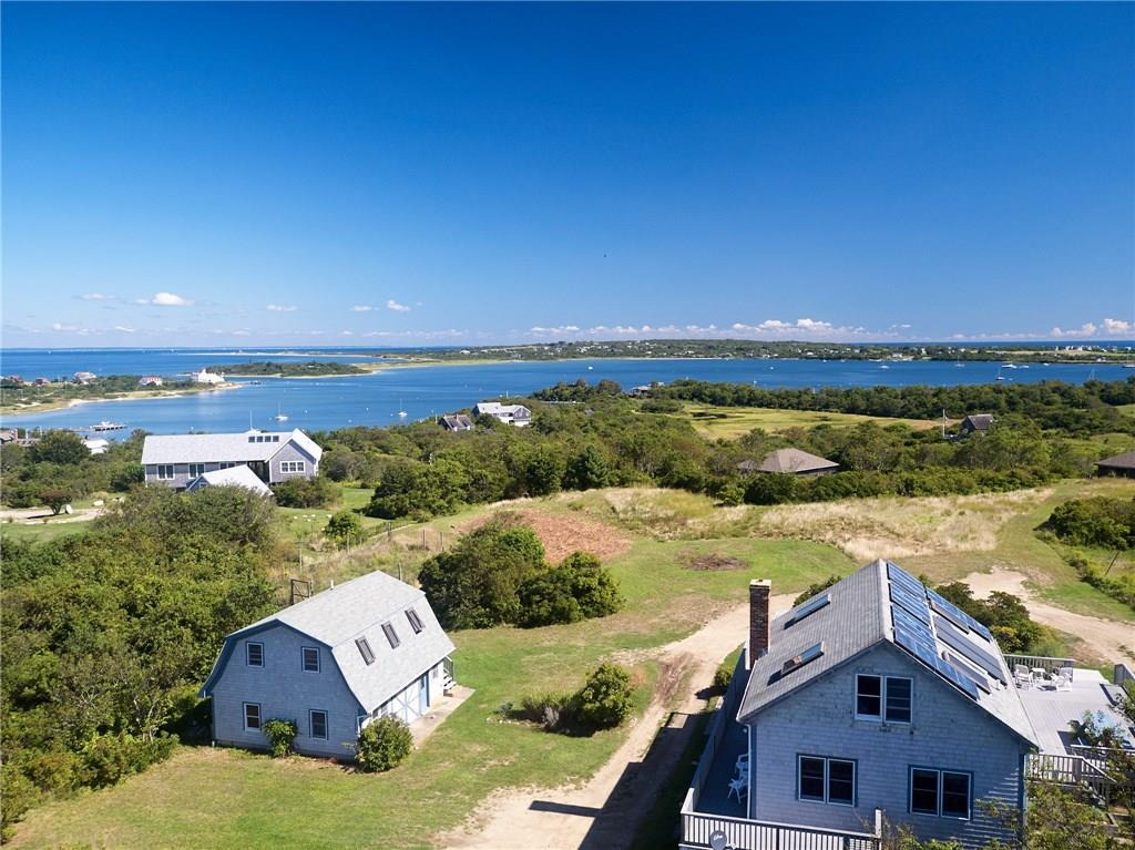 Stunning views and a substantial 3.48 acre parcel on Coast Guard Road will command your attention.  This private setting offers a year round home plus detached guest house, tons of storage and lots of potential.  As part of the Cormorant Cove Association, the property shares the ownership, usage and access to Great Salt Pond on a lovely stretch of beach bordering the Cove.  A pedestrian ROW connects to lower Coast Guard Road and the waterfront is only minutes away! From sunrise to sunset, from North Light to the South East, you will enjoy more than 180 degree water views encompassing Great Salt Pond, Block island Sound and the Atlantic Ocean.  Come see the possibilities!