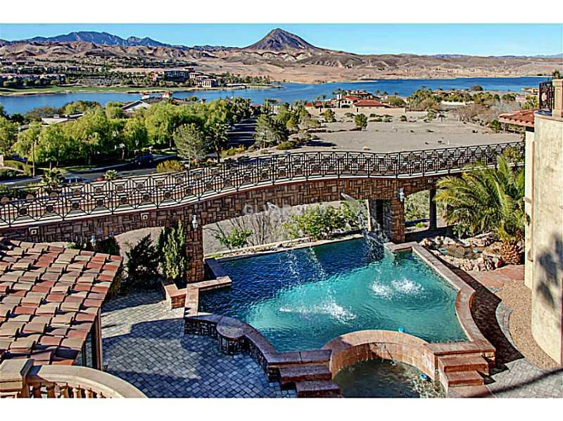 "Unbelievable Mediterranean style Resort on .74 acres considered ""The Luxury Estate"" in Lake Las Vegas! 4 levels of luxury w/an observation deck w/commanding views of all of Lake Las Vegas! 2 masters, 2 casitas, several offices 25k + bottle wine cellar w/tasting rm, a FP, flat screen & secret door to private cellar. Sensational marble, stone, slate, pecan wood floors. 2 elevators, 3 stair cases, medallions, library, smooth"