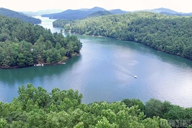 Great lot for building a lake estate on Glenville. The lot has a 3 bedroom septic installed, shared well and deeded water access.  The lot from Lakeshore Drive may seem steep, but once you are at the top of the property, the lot is level. It offers great views of Lake Glenville and a small view of the mountains in the distance.  20 foot Deeded water access is located on Lakeshore Drive where the road splits.  Best of all this lot is located close to Cashiers Cross Roads, Trillium, Mountain Top and OEC.