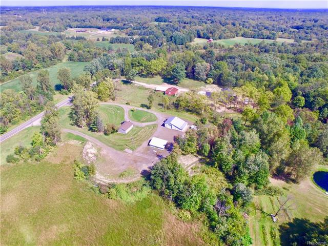 8 acres! 50 x 45 Barn, Concrete, water, electric ~ 2nd Building 25 x 30 Concrete electric 3rd building is Chicken Coop,  and pen. 2nd Driveway to 5.26 acre parcel on separate tax code with (old well) 2 tax codes included in sale see Legal description,  This Recently remodeled  Ranch home has ceramic  in full bath with Jacuzzi Tub. Hardwood floors on entire main level.  Newer Hot water tank and furnace and Water softener.