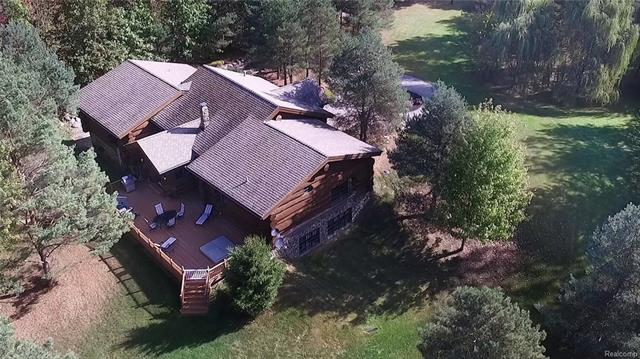 Unique custom log home on almost 20 acres of wooded land. Could be Up North, but still close to everything in North West Oakland County. Private road with gated entry. All top featured appliances, 2 story stone fireplace in great room. Formal dining room, entertainers bar. Large deck off 4 season sun room. Finished daylight basement with wine cellar. 24 hour notice to show.