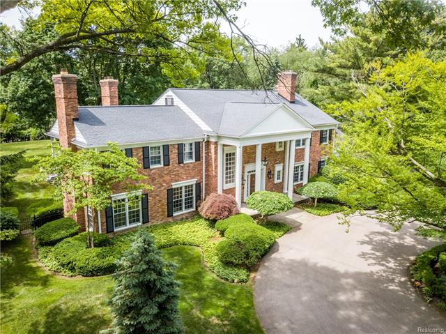 Stately traditional estate set on 1.8 acres in the heart of Bloomfield Hills. Grand 2-story foyer offers a warm welcome and flows to elegant living room with floor to ceiling windows, an expansive family room with stunning wall of built-ins, wet bar & game area as well as red cherry paneled library – all with fireplaces. The sophisticated light-filled kitchen features state-of-the-art appliances, breakfast area, command center and opens out to the expansive outdoor seating areas as well as a gracious dining room. Upper level is comprised of 3 ensuite bedrooms, 2 add'l bedrooms and full bath, study/play area and  fabulous master suite highlighted by huge custom walk-in closet and spa-like master bath with stylish stone and wood finishes. A sparkling pool and magnificent sweeping lawns provide plenty of space for entertaining. Boasting a serene, pastoral ambience this sophisticated yet relaxed home is located close to the Cranbrook Community. 2 laundry rms, generator, 3 car heated garage