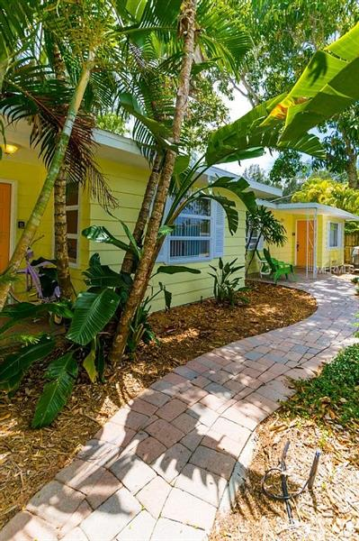 "**DAILY RENTALS** $41,4335 YTD 2018 Booked **Island style with tropical vibrancy, this 2-unit duplex located on fabulous Siesta Key offers vacationers their own slice of paradise. Being just steps away from the #1 beach in America, surrounded by lush gardens including a bountiful Mango tree, and heated swimming pool this turn key furnished RMF Zoned home is a phenomenal investment opportunity—allowing for DAILY RENTALS. The home is comprised of two separate units under the same roof; ""Cabana 1"" features 2 bed/1 bath, while ""Cabana 2"" features 2 beds/2 bath; each are equipped with spacious eat-in kitchens with granite countertops, stainless appliances, and an abundance of natural light; open floor plans; and private laundry. The outdoor amenities include a gas grill, charcoal grill, beach bicycles, and all the beach going essentials including towels, chairs, coolers, etc. The vacation rental market is in a period of massive growth. More tourists are finding that vacation home rentals fit their needs better than a hotel or resort. This surge in supply and demand is demonstrated by the major vacation rental listing sites such as: HomeAway, VRBO and Airbnb, while online travel agencies such as Expedia and Booking are listing vacation homes alongside hotels. This charming rental home already has 155 nights rented for 2018 and it's only February!"