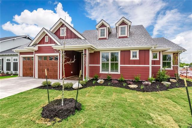 Modern farmhouse meets classic Craftsman! Dorm windows, solid wood contemporary front door w/ glass panes, faux wood garage doors, solid wood interior doors, handscraped engineered flooring & modern/luxury light fixtures! Open concept floor plan w/ natural light galore! Kitchen has farmhouse sink, chrome pot filler, Jenn Air appliances & modern white quartz island. Dedicate office + mud area w/ reclaimed wood bench! XL covered back patio has 2 ceiling fans/stained concrete. Yard is irrigated/fully fenced!