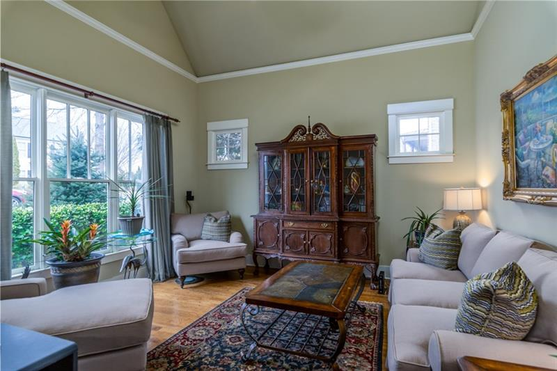 Formal Living Room/study/office with cathedral ceilings.