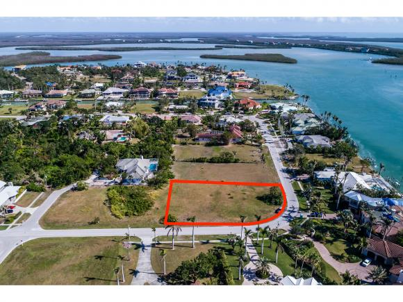 Rare to find HUGE corner lot in prestigious Estates Area of Marco Island! Over one half acre of land sits across from Multi-million dollar homes, within walking distance to the Gulf! Not many like this available! Don't miss this wonderful opportunity!