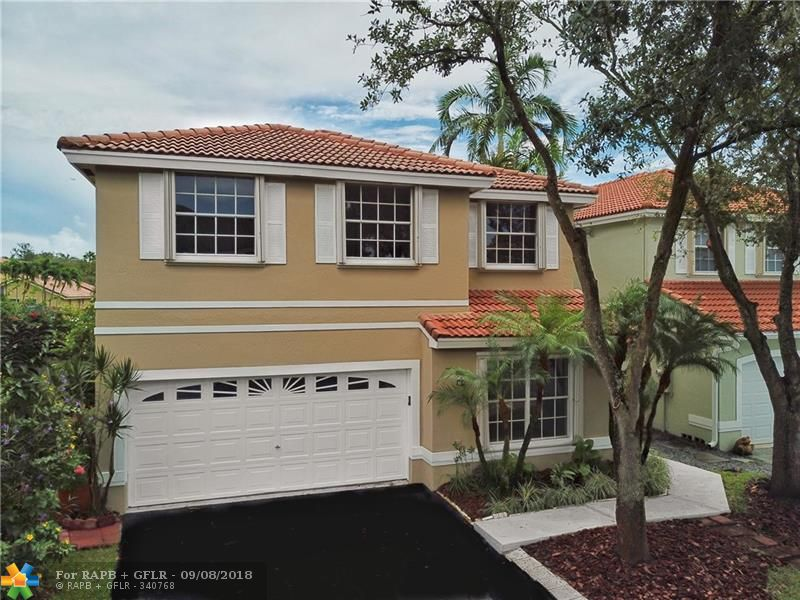 YOU WILL FEEL RIGHT AT HOME WHEN YOU ENTER THIS CHARMING AND UPGRADED 2 STORY HOME IN THE HEART OF WESTON. WOOD FLOOR THROUGHOUT, UPGRADED KITCHEN AND BATHROOMS BATHROOMS, ACCORDION SHUTTERS THE HOUSE HAS GORGEOUS WATERVIEW ALL IN GATED COMMUNITY WITH POOL, WALKING DISTANCE TO A+ SCHOOLS AND PARKS. COME VISIT US ON SATURDAY AND SUNDAY FROM 1:00 TO 3:00 PM.