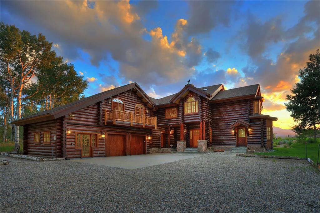 This Montana style lodge is located behind a gated entry on 20 acres over looking the expansive valley below. With some of the best views you will find anywhere.   The owner has updated and improved almost everything.  This home is complete with nothing to do except enjoy. Featuring 5-bed 5 bath 4 fireplaces.  Fantastic great room, multiple decks with views, hot tub, fire pit, awesome kitchen, TV room with bar and a caretaker suite.  The Master bedroom is a dream.  This is a Must see property.