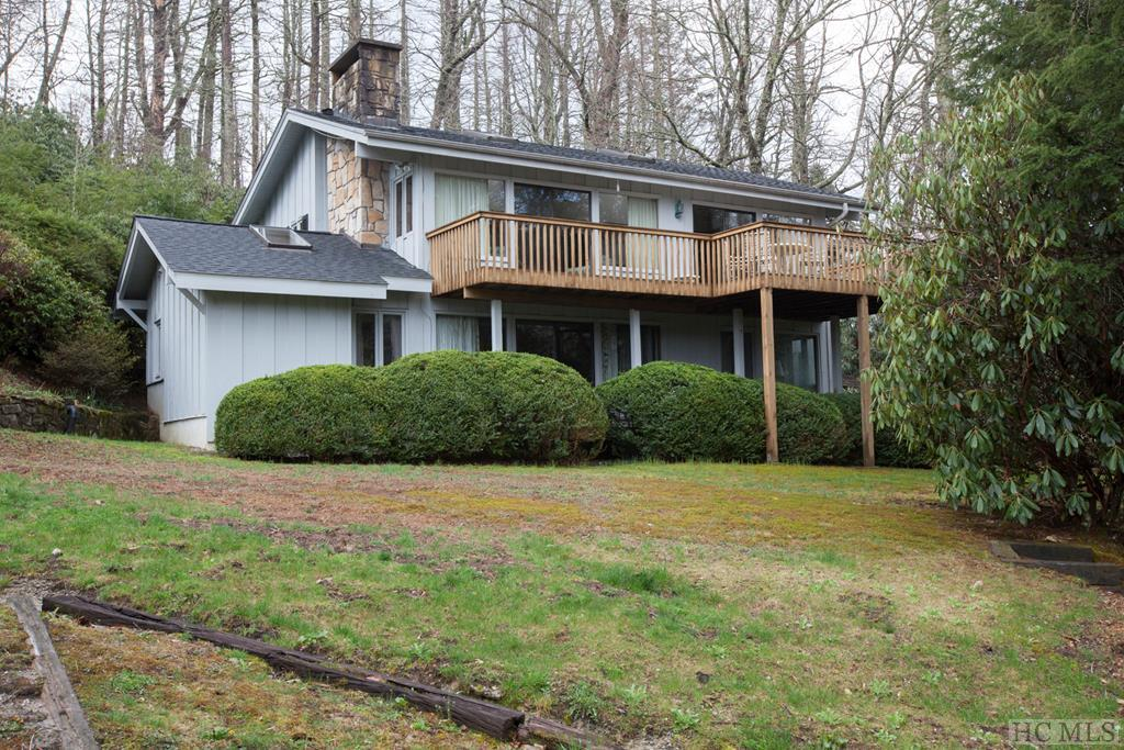 "This is a rare combination of BOTH Lake Views and Mountain Views!  Prime close-to-town location, the Cold Springs neighborhood is quintessential Highlands in every way.  Equestrian, Tennis, Hiking, Paddling, and Fishing are at your doorstep here. This Listing includes and extra lot along the trout stream.  The 4-bedroom split level layout provides plenty of privacy for all.  You will love the stone fireplace in the Master.  A vintage cottage style kitchen with adjoining screened-in porch will have you sipping coffee each morning in a natural setting.  Both levels open up to the decks and magnificent view of Cold Springs Lake and Shortoff Mountain.  Perhaps the great outdoors is calling you right now.  Come enjoy the expanse of trails-trout streams-waterfalls-bird watching-and championship golf.  You can move right in to this property, so just bring a toothbrush.  But, If your investment plans include a budget for a remodel with plenty of upside...this in one you should consider.  You'll love the location due to it's proximity to Highlands/Cashiers Hospital and downtown Highlands.  The ""scene"" in town includes the Old Edwards Spa and Hotel, restaurants galore, ""shop-til-you-drop"" opportunities, and cultural assets like music, theatre, festivals, and more.  Cold Springs....Choose Lifestyle versus settling for an address!"