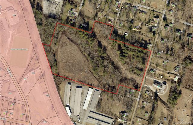 Excellent development parcel just minutes from downtown Hendersonville.  Has two zonings split by the stream.  Back portion is R-15 and the front portion is Neighborhood Commercial.  Many possible uses.