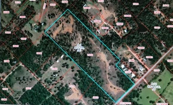 Secluded 23 Acres, Excellent for hunting with a perimeter fence. Property is bound by a wet weather creek. Scattered Trees with Electricity on property.