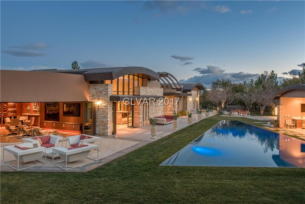 This is quite possibly the best finished home in Las Vegas with over $15m originally spent.This is a 1.75 acre estate compound that includes the secondary lot and 5,000sf guest house at 55 Skybird.Over$1.5m spent in electronics alone including unrivaled state of the art movie theater. Classic Mid Century Modern interior design. Amazing views of the entire city as well as the mountain range whilst retaining total privacy
