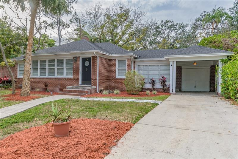 """DAVIS ISLANDS delight...This Charming 3/2 fenced home located on the peaceful and beautiful tree lined street of Bosphorous Ave. The home sits on nearly 1/4 ACRE (10,857 sq ft) with 78' of frontage and 139' deep and NO large oaks.  The home FEATURES open floor plan, UPDATED kitchen with GAS range, stainless steel appliances, stone counter tops, wood cabinets, NEWER ROOF (6 y/o), BRAND NEW GAS water heater, crown molding, hard wood flooring, dining area, bonus room, living room with fireplace and lots of natural light.  Property boats MASSIVE backyard with LARGE WORKSHOP (10x15) on poured slab, pool with outside bath, large concrete deck, 1 car garage and covered carport. This charming home is located within Plant, Wilson and Gorrie school districts. Davis Islands waterfront community features an airport, community pool, public boat ramp, marina, tennis complex, dog park, biking and walking path. Property is located close to DI business district featuring RESTAURANTS, BARS, and SHOPPING. Property management company has over seen the home since 2006, with a monthly rent of $2,500.  Property is being Sold """"AS IS"""" for convenience of Seller. Pool needs updating and in """"as is"""" condition. Opportunity awaits to make this DAVIS ISLANDS home yours today!"""