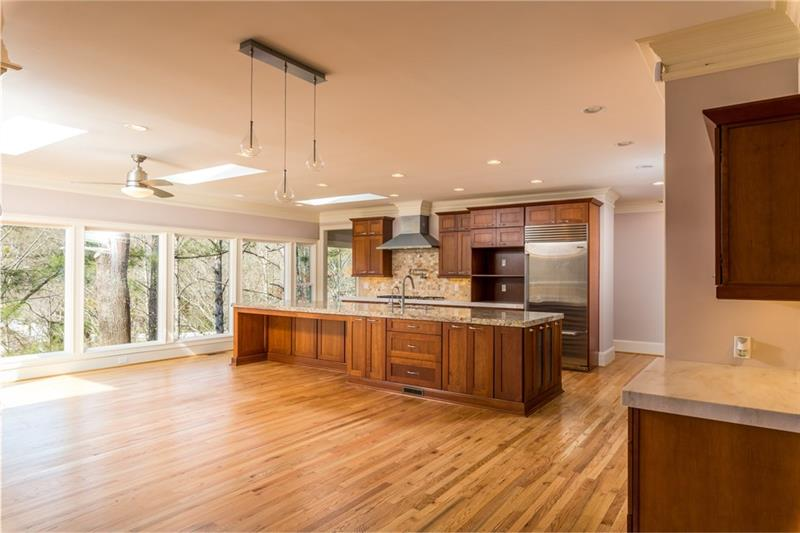 Absolutely enormous kitchen & breakfast area with a wall of windows overlooking the beautiful, flowing creek!