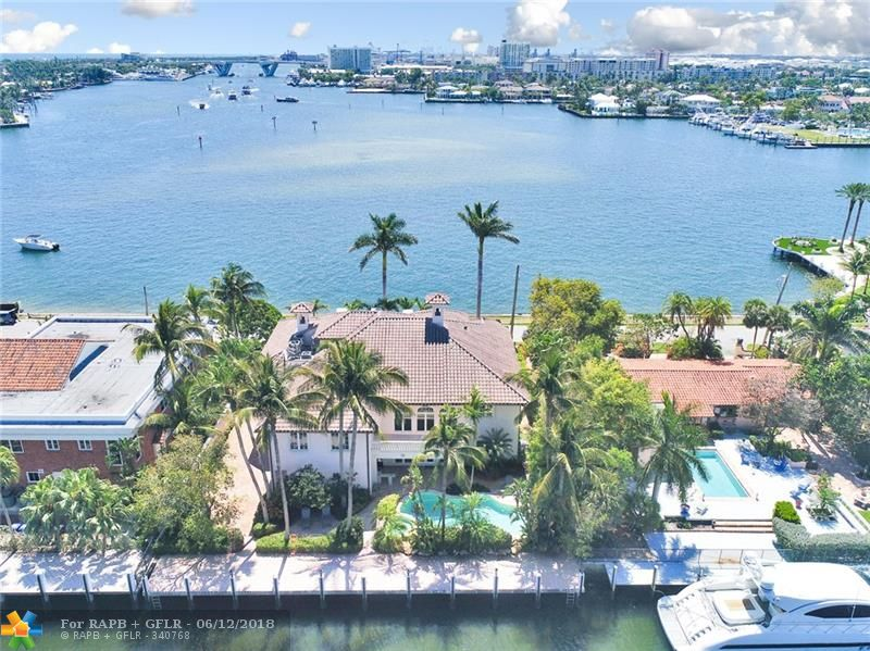 **AWARD WINNING WATER VIEWS**  Huge unobstructed water views looking south towards the 17th St. Causeway & Intracoastal waterway. 100' of dockage for an 80' yacht mins to Port Everglades &beyond. Masterfully constructed & designed w/ an open & bright floor plan, perfect for formal/informal entertaining. Grand entrance w/ 20' coffered ceilings, exquisite marble floors,movie room & executive office. Third story entertaining room/bar/balcony afford Broward's finest views.  Drone: https://youtu.be/lnBlfV84-zw