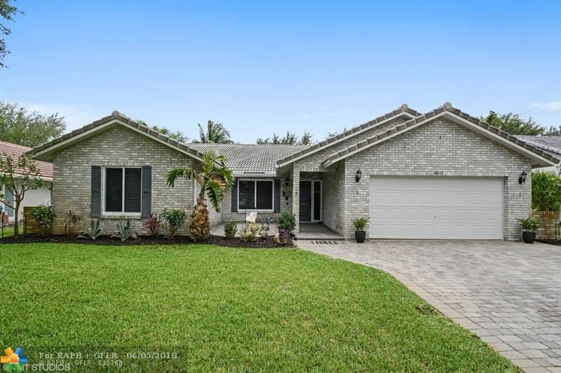 """WOW! ABSOLUTELY PERFECT RENOVATED HOME WITH 2014 IMPACT WINDOWS & DOORS, HONEY MAPLE AND GRANITE KITCHEN, HIGH-END REMODELED MASTER BATH, 2004 S-TILE ROOF, 2015 A/C, 18"""" TILE, AND MORE ON AN OVERSIZED 1/3 ACRE 175' DEEP LOT IN POPULAR PINE RIDGE!"""