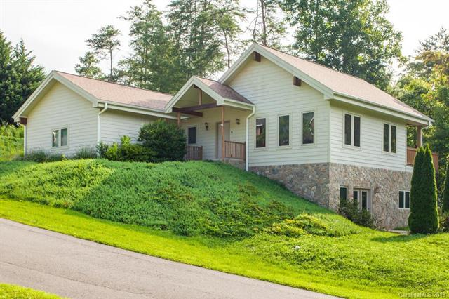 Single level living in this awesome Lindal Cedar home with dramatic cathedral beamed ceiling in great room, granite counter kitchen, luxurious main level master suite.  Basement ready for entertaining with wet bar, unvented gas log fireplace and access through French doors to the patio.  Conveniently located near a semi private golf course and a short drive to Weaverville's shopping and dining with downtown Asheville only 20 minutes away.