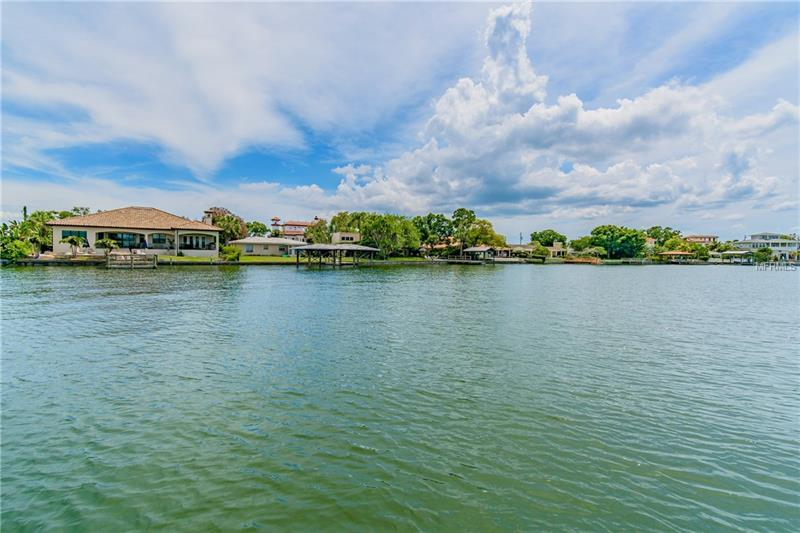 Ready to live on the water in South Tampa? This three bedroom/two bath home is ready for you! This beautifully maintained 1,679 square foot pool home, located in the Plant High School district, features a newer kitchen, master bedroom with private bath, living room, office space and family room/dining room with views out to the pool and the gorgeous canal. There is a two car garage and driveway with space for boat storage or multiple cars. The home sits on an 83 x 130 deep water canal lot with easy access to Old Tampa Bay. The 83' seawall allows room to accommodate a 60' yacht. There is an existing covered dock with a lift for smaller watercraft. The lot is unencumbered by trees which makes it perfect if you would like to build! Don't miss this rare opportunity with so many options!