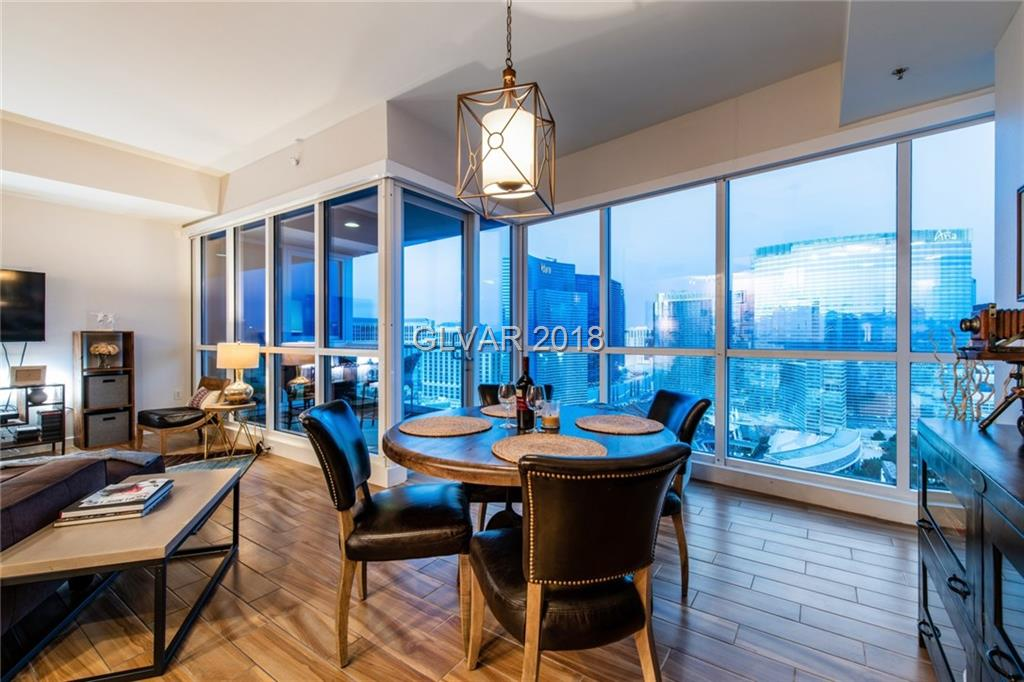 Gorgeous & Fully Furnished on the 28th Floor with HUGE Strip Views! Professionally decorated with stylish sophistication, this 2 bed/3 bath unit features a wide open living space & Legendary Views from ever angle. Massive master suite with 2 walk in closets, oversized bath with luxurious soaking tub. Upgrades include electric shades, custom wifi lighting & beautiful wood tile flooring. Much-coveted 2 parking spaces included - YES!! MUST SEE!!