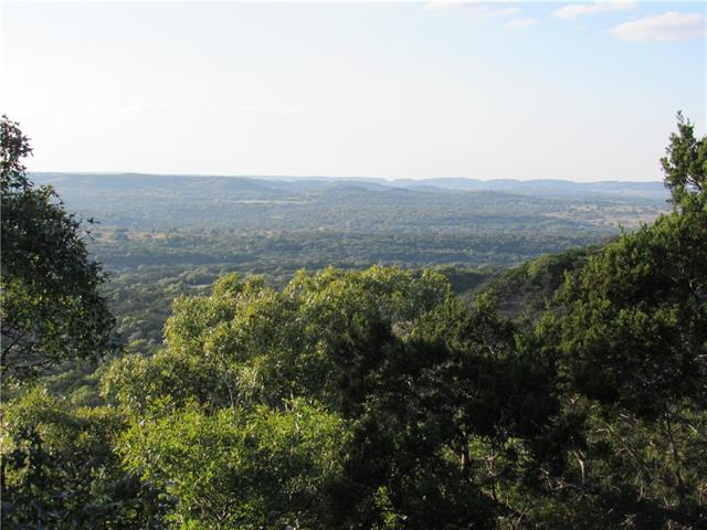 "Miles & miles of Texas can be seen from just about anywhere on this predominately high elev & nicely treed ranch having FIVE significant & pronounced hilltops with elev. ranging from 1320' to a whopping 1651'. Included is a 2.5 acre stocked lake & the highest hilltop is the loc. of the fine 2624 sf. custom, 3/3/2 home. The architecturally designed masterpiece is super efficient w/limestone ext, standing seam metal roof, a 40,000 gal rainwater system, & can be totally ""off the grid"". Call for more details."