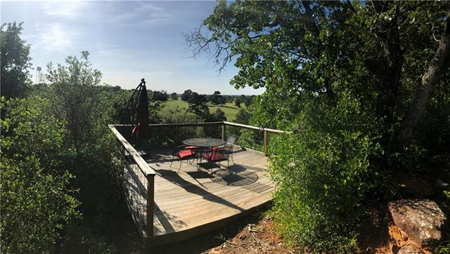 Located on highly desirable Sandy Road, gorgeous 15 ac. property complete w/ a 4 bed/2 bath 2,082+/- sf (Appraiser) home situated on top of the hill, as well as, a separate 892+/- sf (Appraiser) studio/guest house! Inside the home is an open floor plan that allows for easy flow, a second living room & a kitchen that offer lots of storage! Property has many established walking trails, plus a patio lookout! The lookout sits on the corner of the property & overlooks adjoining ranch with manicured pastures.