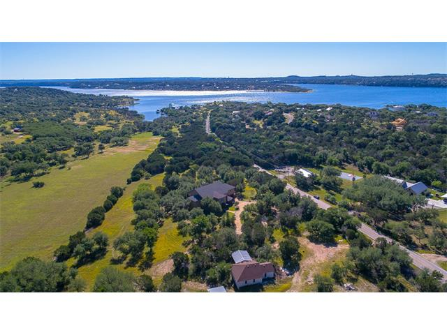 Great property for a business owner.  Live and enjoy 5.28 acres and a warehouse/shop nearby on same gated property.  Minutes from the lake, community dock and access to Lake Travis.  Beautiful oak trees abound along with native grasses.  Live in the country but be within 15 minutes of Galleria, 10 minutes from the newest middle school and minutes from newest elementary school.