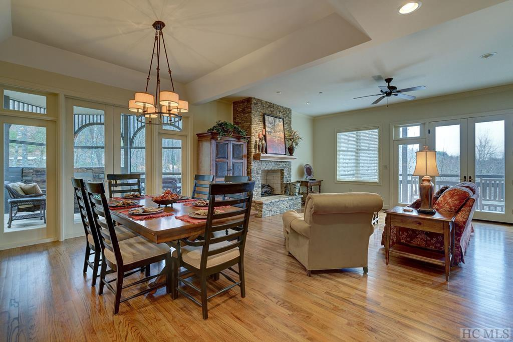 End unit with a lot of privacy and minimal steps going in. This 3 bedroom, 3 bath condo has been completely updated and offers beautiful hardwood floors, stacked stone fireplaces (one in living room and one on screened porch), granite, stainless appliances, frameless showers and freshly painted walls, ceiling and trim. Enjoy the sound of the stream nearby from the screened porch. Furnishings are available for purchase. Owner financing available.