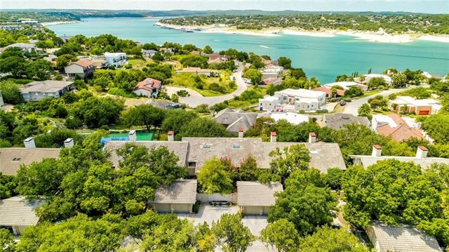 Updated lock & leave condo in picturesque hills of Lakeway w/panoramic lake views! Spacious high ceilings in living, kitchen & master-both offering sliding glass doors to overlook the lake. Tons of upgrades throughout! Kitchen has upgraded quartz counters, subway backsplash, farmhouse sink, & stainless steel. Master has spiral stairs to large flex space perfect for many ideas - library, office, work out room. The downstairs bed currently used as 2nd living! Oasis looking upon Lake Travis w/two-level deck!