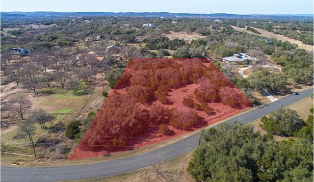 Beautiful 5+ acre lot in the gated community of Paleface Ranch- Where you are close to city conveniences and great schools, yet feel like you are in the country! This gorgeous property slopes slightly upward from the road and is mostly level, so there are plenty of easy build sites for your dream custom home! Pedernales River access is a short distance away at the HOA park which features a boat ramp, parking, dock & fishing area.  Up to 2 horses are allowed on this lot. Renowned Lake Travis Schools!