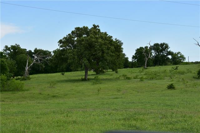 80+ acres of ranch land made up from 2 parcels R77756 and R78472.  Good coastal fields. 2 stock tanks & spring fed creek. Lots of deer, dove, quail, turkey. Will not split up !!! Currently ag exempt. No restrictions. Call agent for combo code.