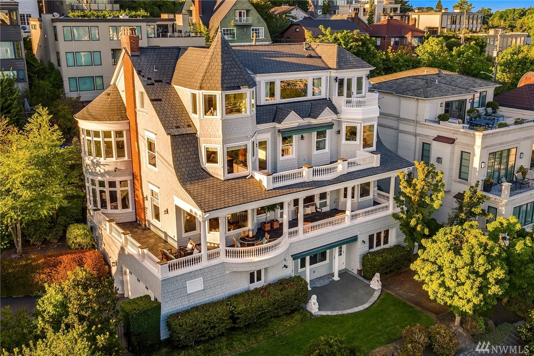 Sited on the south slope of Queen Anne overlooking Seattle, the Space Needle and Puget Sound- this iconic home offers unmatched views.  Meticulously restored from head to toe- with high-end finishes and period details. Spacious kitchen has a butlers pantry, island seating, gorgeous built-ins and eating area w/views. Three balconies overlook the skyline and virtually ever room offers expansive vistas. Six bdrms, 5 baths, guest suite/nanny area, wine cellar, theatre room, yard and two car garage.