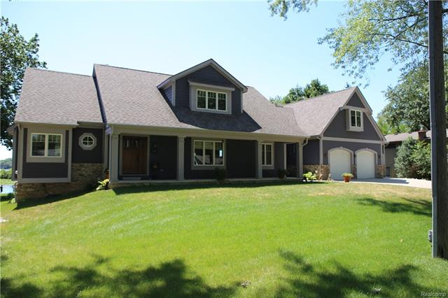 REMARKABLE MUST-SEE TRUE CUSTOM BEAUTY ON QUIET COVE OF ALL SPORTS LOWER STRAITS LAKE! HARD ROCK MAPLE FLOORS THROUGHOUT OPEN PLAN ENTRY LEVEL, STUNNING LAKE VIEW, DISTINCT CHEF'S KITCHEN W/ HIGH-END APPLIANCES, SLATE FLOORS CORIAN COUNTER TOPS. 1ST FLOOR MASTER, HEATED FLOORS IN MASTER BATH, HIS/HER WALK-IN CLOSETS. 2ND FLOOR OVERLOOKS LIVING ROOM, CYPRESS FLOORS, 3 BEDROOMS AND LARGE VERSATILE SPACE PERFECT FOR HOME OFFICE OR IN-LAW'S SUITE W/ PRIVATE ENTRY TO GARAGE AND EXTERIOR. PRE-PLUMBED LL W/ GARAGE. HUGE GARAGE  W/HEAT, A/C, FLOOR DRAIN, UTILITY SINK.
