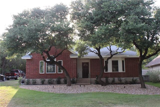 Updated 1 story open plan in Lakeway proper. No HOA! Near Lake Travis & Lakeway City Park. Home remodeled in 2017 incl: hardwood (Bamboo), hard tile, carpet in bedrooms; kitchen updated w/Quartz counters, subway tile backsplash; new cabinet fronts. New paint (Sherwin Williams neutral grey) 2017, new light fixtures. New side deck, fresh landscaping front and back, back gutters, outdoor uplighting showcasing the oak trees. Recent (2015) roof, appliances, and front windows. Gorgeous custom woodwork! Trees!