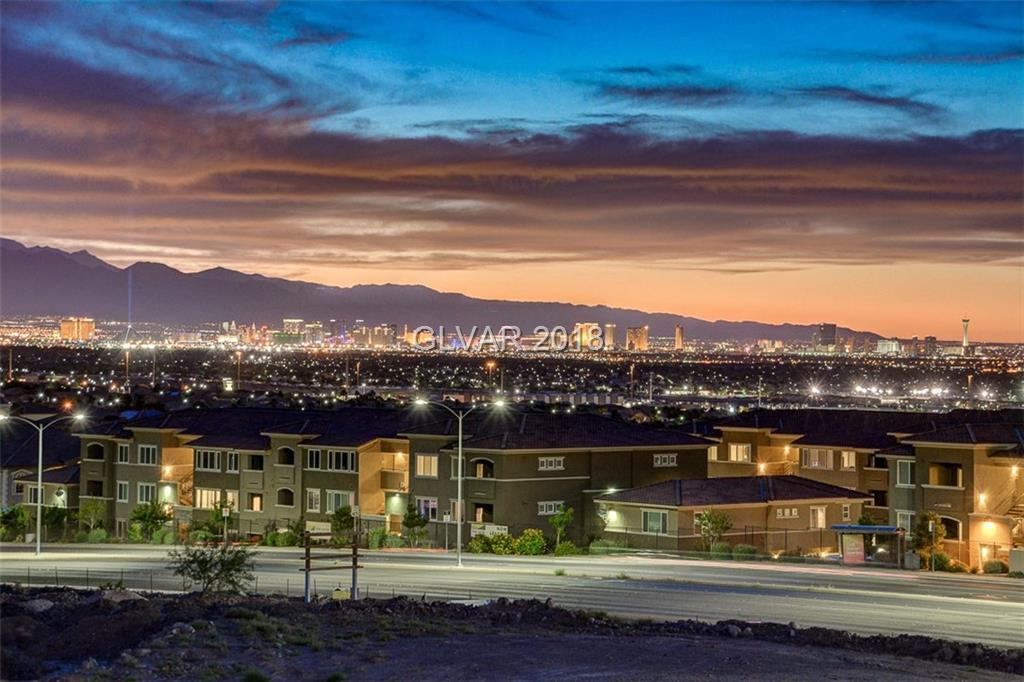 **MASSIVE PRICE DROP*Spectacular City, Mountain, and Strip views on a premium lot.  This spotless open concept home features; Over 3,000 sf. of living space with Quartz counters, custom cabinets, and paint. Tray ceilings and ceiling fans top the well-appointed rooms; Master with 2 closets, 2 bedrooms, and 2 Bathrooms up, 1 bedroom and 2 bathrooms down, great room, media room, loft and spacious bedrooms offer plenty of space to entertain or relax.