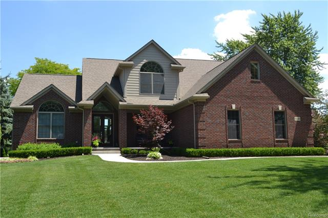 Stunning Lakefront in Commerce Township! 1 1/2 Story Cape Cod located on All Sports Lake Sherwood. 3 Bed, 3 full & 1 half bath. Lakeside 1st floor spacious MB w/ deep WIC. Spa like M bath w/ upscale Travertine tile, Ronbow & Kohler dual sinks, Ronbow soft close cherry vanity & walk in shower! Spectacular great room w/ soaring ceilings, architectural tile fireplace & outstanding views of lake! Beautiful, granite kitchen w/ Decora cherry soft close cabinetry & under counter lighting. Kit appl. stay w/ wine refrigerator! 1st floor laundry, LG library/office, powder room w/ Hansgrohe faucet & Travertine tile complete the main floor. Upper level offers LG loft area, 2 spacious BR w/lakeside views. 2 full baths w/ Travertine tile, Ronbow vanity & trackless shower glass door!  Lower level offers plenty of storage area & is prepped for bath. Beautiful 2 tier Ledgestone patio for outdoor entertaining. Sandy beach area, drywall in 3 car garage. Exclude light fixture in breakfast nook & foyer.