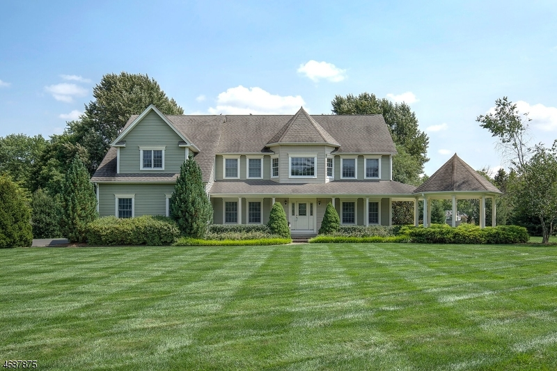 Inviting 2005 Custom-Built Colonial features a covered front porch and corner gazebo to welcome you with style and grace. This exceptional residence has an open floor plan with oak hardwood floors
