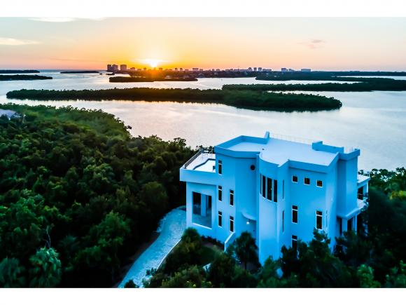 The Epitome of Luxury Living! Unscathed by hurricane Irma! Complete concrete home! This extraordinary home boasts 6500 SF of lavish interior living space and a total of 12000 SF! 3rd floor pool overlooks Gulf of Mexico with Western exposure where you will never miss another sunset. Widows peak roof top floor overlooks all of Marco Island and surrounding areas! ABSOLUTELY STUNNING VIEWS from every room! Contemporary home on almost an acre of land built in 2014 offers 5 bedrooms, 5.3 baths, 2 master suites, 2 kitchens and a Recreation room! Winding staircase built by the Omish is an absolute breathtaking view when you walk in. No detail left out of this absolutely  incredible home! Bring your most discerning buyer, they will not be disappointed!