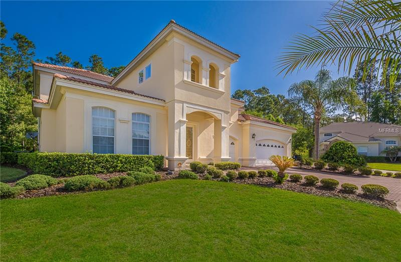 Located in Magnolia Plantation, Lake Mary's Premier gated community surrounded by the Wekiva preserve! Perfect home located on a large private cul-de-sac lot. Located on a quiet street with the perfect floor plan for a growing family! Upgraded screened pool surrounded by designer decking features solar heating, and in ground cleaningsystem. Kitchen with stainless steel appliances, granite counter tops, center island, dark wood cabinets, and large breakfast bar with separate dinette. This home offers a Master Bedroom downstairs with his and her walk-in closets, a Master Bath with his and her vanity areas and a jetted tub. Three large bedrooms upstairs along with a large bonus room that opens up to it's own balcony. Other features include vaulted ceilings, double french doors, tile flooring and intercom/speakers throughout. Land behind home is a conservation area and no development will occur. Energy efficient, with extra insulation in attic. Great home in an exclusive neighborhood.
