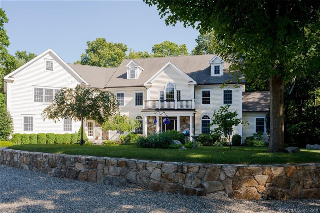 """Traditional combined with elegance, the craftsmanship and radiance in this colonial allows for a lifestyle of luxury within 5,561 square feet. Home is set back off the road on a circular driveway.  It has exceptional stonework on 1.3 acres of pure tranquility, peaceful setting and privacy in South Wilton. The gourmet chef's kitchen with subzero refrigerator, Viking double ovens (1) a convection with warming draw, Viking propane 48"""" burner gas range top with custom hood and pot filler, Asko dishwasher, KitchenAid trash compactor, bar with wine cooler, and butler's pantry.  Kitchen flows through eating area with French Doors to outside deck and stone fireplace in family room. The formal living room has a propane fireplace and adjoining library offers relaxation, and entertainment. Large laundry area with folding table, deep soaking sink with washboard feature, LG large capacity washer and dryer and storage closet. Master bedroom has adjoining master bathroom suite, walk in-closet with 2 additional closets, whirlpool tub, dual vanities and over-sized shower. Four additional bedrooms; 2 with on-suite full bathrooms, the other 2 with a Jack and Jill full bathroom, main level has 2 half bathrooms, 1 mudroom. Classic design, fine finishing details, columns, built-ins and bright sunshine throughout. Legal second kitchen and/or option for an accessory apartment, three car heated garage, security system, 5 zone plus 1 (6 thermostats) hydro-air heating and cooling with a 400-amp service"""