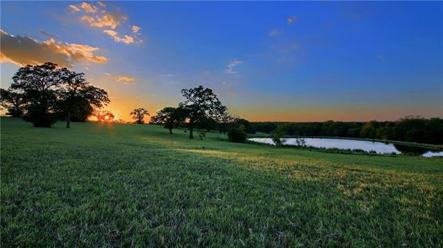 Near Austin. Remarkable 67 acre Gentleman's Cattle Ranch, coastal hay, horses & 3 ponds. A 5,058 sf. Timber Frame & Stone 4BR & 3.5BA home. Steel/wood spiral staircase to loft/game room. Spectacular views by fireplace. Luxurious kitchen, wine room, granite island, copper sink & Thermador appl. Deck overlooks the pool, waterfall and lawn. Master BR rock fireplace, Master BA, copper tub & walk in shower.  Barndo-600 sf - 1 BR, BA, kitchen, laundry, living & GA for guest lodging. Equip Barn 30x70/RV storage.