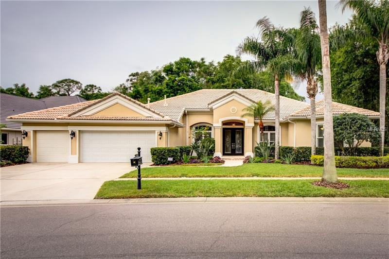 4/3/3, executive home in the Estates section of gated Harbor Links in Westchase.  A private setting, separated from neighbors, with a view of the 16th green of the Westchase Golf Course. Enter through double doors into the foyer, formal living and dining areas, each with tray ceilings, and a custom hutch in the DR.  To the right is the office with spectacular custom cabinetry, and wood floors.  Continue to the oversized Master suite, with tray ceiling, dual master closets, each with custom storage systems, and a gorgeous master bath that will make you forget your troubles.  Here you'll find 2 custom granite topped vanities, an island storage cabinet, and a frameless shower with custom tile work.  Start or end your day in the extra deep jetted soaking tub.  Now to the kitchen to be wowed by custom cabinets, and a huge granite topped island. Appliances include Miele combo microwave, wall oven, and warming drawer, Miele dishwasher, Dacor cooktop, and GE Monogram wine cooler.  Relax in the family room with it's beautiful custom tray and cathedral ceiling detail.  Relax further in the bonus room with surround sound and sliding doors leading to a private patio. The secondary bedrooms have custom closets, wood floors, and ceiling fans.  The pavered lanai, with it's pool and spa, is covered by an oversized arched screen enclosure. The garage has custom storage cabinets, ceiling and wall racks. The house is serviced by a water softener, tankless water heater, and 2 A/C units replaced in 2017.  Call to see today.
